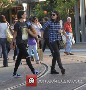 Clea DuVall - Clea DuVall, star of HBO television series Carnivàle, goes shopping at The Grove in Hollywood holding hands...