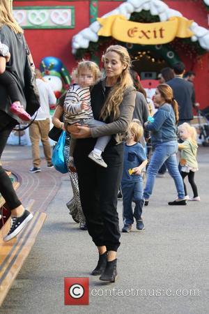 Elizabeth Berkley and Sky Cole Lauren - Elizabeth Berkley Xmas shopping at The Grove - Los Angeles, California, United States...