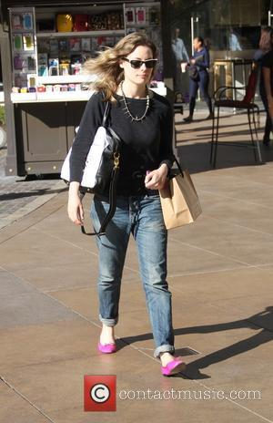Gillian Jacobs - Gillian Jacobs, star of NBC comedy series Community, wears pink flat shoes, rolled up jeans and a...