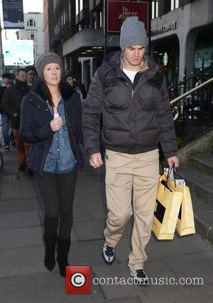 Jonathan Sexton and Laura Priestly - Photographed wearing a sling after his bicycle accident, U2 front man Bono managed to...