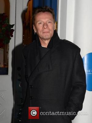 Larry Mullen - Photographed wearing a sling after his bicycle accident, U2 front man Bono managed to avoid the annual...