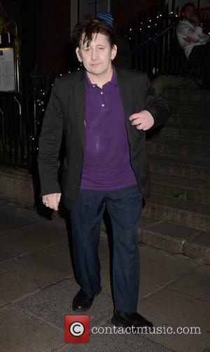 Shane MacGowan - Photographed wearing a sling after his bicycle accident, U2 front man Bono managed to avoid the annual...