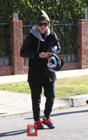 Shots of Canadian actress Ellen Page as she left the gym wearing a beanie hat, black coat and grey hoodie...
