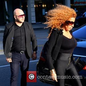 Afida Turner - Afida Turner and Lloyd Klein arrive at the Montage Hotel in Beverly Hills - Los Angeles, California,...