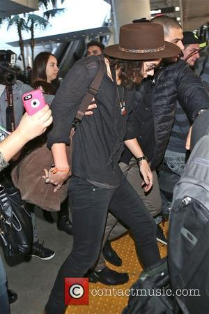 Shots of British pop star and member of the boy band One Direction Harry Styles as he arrived at Los...