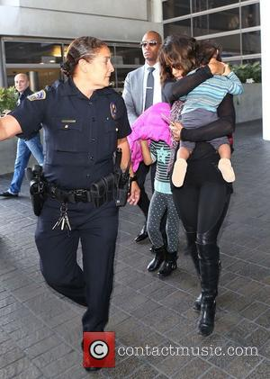 Halle Berry and Maceo Martinez - Halle Berry arriving at Los Angeles International Airport (LAX) with her son, Maceo at...