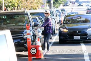 Naomi Watts - Naomi Watts out and about running errands in Los Angeles wearing a checked shirt, floppy hat and...