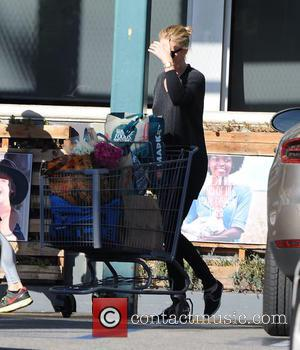 Charlize Theron - A very camera-shy Charlize Theron goes shopping at Whole Foods Market in Los Angeles - Los Angeles,...