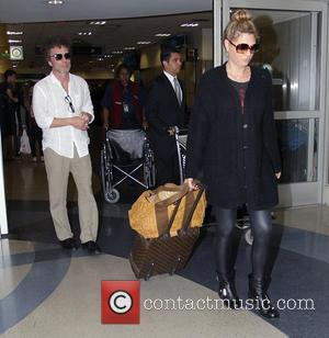 Daisy Fuentes - TV presenter Daisy Fuentes departs from Los Angeles International Airport (LAX) with a male companion - Los...