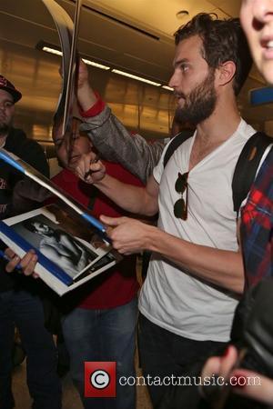 Jamie Dornan - Jamie Dornan arrives at Los Angeles International (LAX) airport - Los Angeles, California, United States - Wednesday...