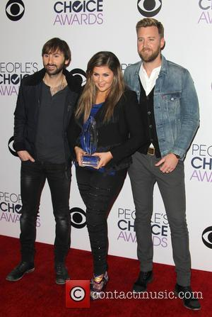 Dave Haywood, Hillary Scott and Charles Kelley - A variety of stars were photographed as they took to the red...