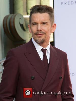 Ethan Hawke - Photographs of the American actor Ethan Hawke as he placed hand and footprints in cement during a...
