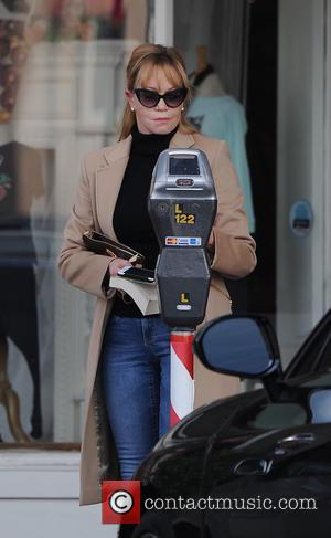 Melanie Griffith - Melanie Griffith enjoys a cigarette while out shopping at Larchmont Village Plaza - Los Angeles, California, United...