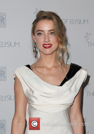 Amber Heard - A variety of stars were snapped as they arrived for the Art of Elysium's 8th Annual Heaven...