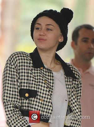 Miley Cyrus - American pop star Miley Cyrus and her boyfriend Patrick Schwarzenegger were spotted as they arrived at The...