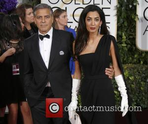 George Clooney and Amal Alamuddin Clooney