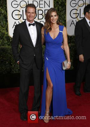 Rande Gerber and Cindy Crawford - 72nd Annual Golden Globe Awards at The Beverly Hilton Hotel - Arrivals at Golden...