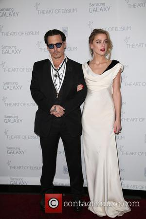 Johnny Depp and Amber Heard - A variety of stars were snapped as they arrived for the Art of Elysium's...