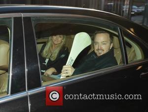 Aoiffe Madden & Aaron Paul - Breaking Bad actor Aaron Paul seen leaving Wilson Hartnell PR offices carrying a Hurley...