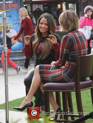 Christina Milian - Christina Milian conducting an interview at The Grove in Hollywood wearing sky high heels - Los Angeles,...