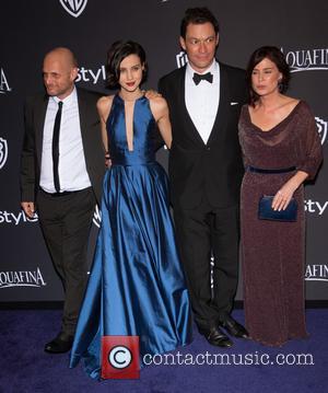 Julia Goldani Telles, Dominic West and Maura Tierney