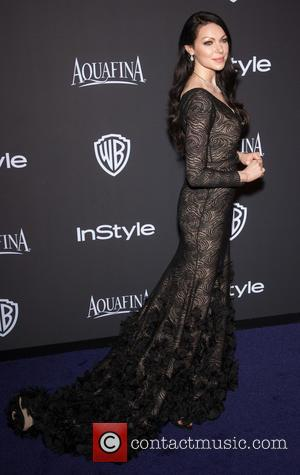 Laura Prepon - 16th Annual InStyle and Warner Bros. Golden Globe afterparty - Arrivals at Beverly Hilton Hotel, Golden Globe...