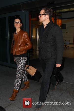 Colin Firth and Livia Firth - Colin Firth arrives at Heathrow airport with his wife Livia - London, United Kingdom...