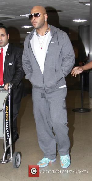 Shots of American rapper Flo Rida as he arrived at Los Angeles International Airport wearing a grey Nike tracksuit in...