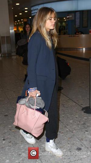 Cressida Bonas - Cressida Bonas arrives at Heathrow airport from Los Angeles carrying a pink Louis Vuitton handbag - London,...