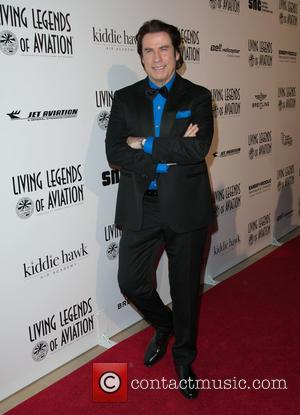 John Travolta - A host of stars were snapped as they arrived at the Beverly Hilton Hotel for the 12th...