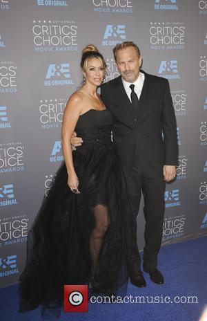 Christine Baumgartner and Kevin Costner