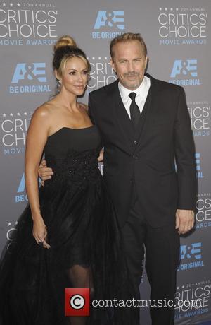 Kevin Costner and Chistine Baumgartner