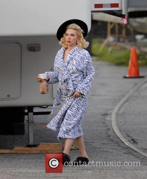 Scarlett Johansson - Blonde bombshell Scarlett Johansson wears a zebra print bathrobe the set of 'Hail, Caesar!' currently filming in...