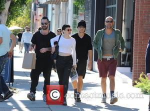 Rose McGowan and Davey Detail - Rose McGowan rocks a crop top and purple lipstick while out shopping with her...