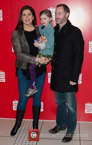 Amanda Lamb and Guest - Big Hero 6 UK Gala Screening held at the Odeon Leicester Square - Arrivals. at...