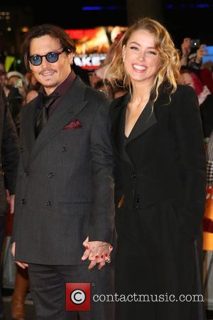 Johnny Depp and Amber Heard - The UK premiere of 'Mortdecai' held at the Empire cinema - Arrivals - London,...