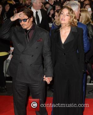 Johnny Depp and Amber Heard - 'Mortdecai' U.K. Premiere at the Empire, Leicester Square - Arrivals - London, United Kingdom...