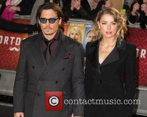 Amber Heard and Johnny Depp - A host of stars were photographed as they attended the UK premiere of 'Mortdecai'...