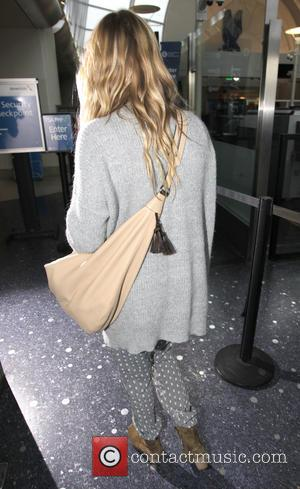 LeAnn Rimes - LeAnn Rimes departs from Los Angeles International Airport (LAX) - Los Angeles, California, United States - Tuesday...