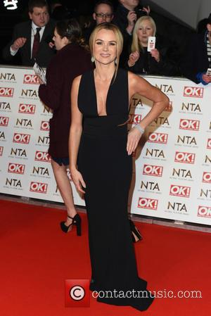 Amanda Holden - A host of British television stars were photographed on the red carpet at The National Television Awards...
