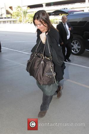 Pamela Adlon - Pamela Adlon arriving at Los Angeles International Airport (LAX) to catch a flight at Hollywood - Los...