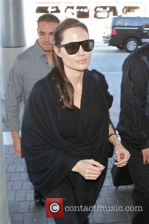 Angelina Jolie - Angelina Jolie departs from Los Angeles International Airport (LAX) - Los Angeles, California, United States - Friday...