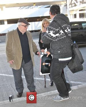 Ed Asner - Actor Ed Asner poses for a selfie as he arrives at LAX airport in Los Angeles -...