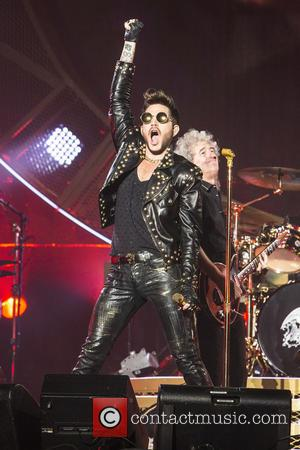 Queen and Adam Lambert - British rock legends Queen and Adam Lambert perform at the Barclaycard Arena as part of...