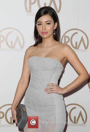 Christian Serratos - A variety of stars were photographed on the red carpet as they attended the Producers Guild of...