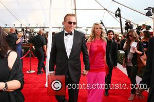 Kevin Costner and Christine Baumgartner - 21st Annual Screen Actors Guild Awards Arrivals at The Shrine Auditorium - Arrivals at...