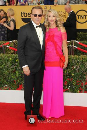 Kevin Costner and Christine Baumgartner - A host of stars were photographed on the red carpet as they arrived at...