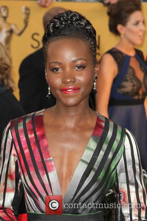 Lupita Nyong'o - A host of stars were photographed on the red carpet as they arrived at the 21st Annual...