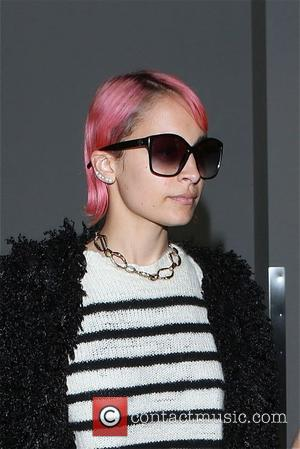 American fashion designer and TV personality Nicole Richie was spotted at Los Angeles International Airport sporting bright pink hair in...