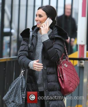 Christine Bleakley - Christine Bleakley chats on her mobile phone outside ITV Studios - London, United Kingdom - Thursday 29th...